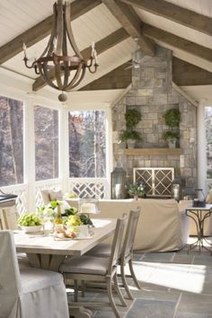 stone fireplace, sunroom, tile floors