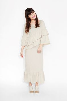 Some girls just wanna have frills - they just wanna! Ankle-nipping length and flamenco sleeves, this dress will have you barefoot picking wildflowers. colour: conch shell cream  In a size small the chest width is 82 cm and the length is 120cm. The model is 157 cm and is wearing a size small.