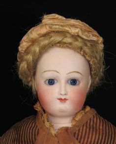 "OVER VIEW: This wonderful 12"""" French Fashion doll is the early Bru lady with a Barrois-type face. As expected of these early Bru ladies, she is marked B. Jne and depose. She is pictured on page 36 of"
