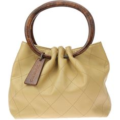 Pre-owned Chanel Beige Lambskin Leather Wooden Circle Bag ($625) ❤ liked on Polyvore featuring bags, chanel bags, handle bag, beige bag, lambskin bag and zipper bag