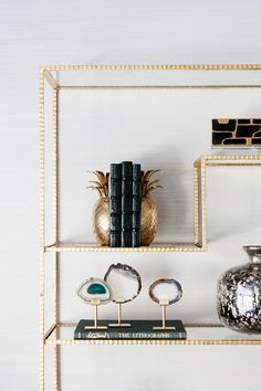 Minimalist gold bookshelf style with Agate pieces