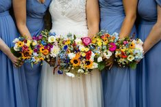 Beautiful bright flowers for the bride and bridesmaids created by Haze Lea Floral Design. Love the blue of the bridesmaids dresses here Photo by Emma and Rich Tythe Barn, Bicester Wedding Photography - Katie + Eamon Burgendy Wedding, Blue Wedding Flowers, Wedding Colors, Blue Bridesmaid Dresses, Bridesmaid Flowers, Brides And Bridesmaids, Floral Wedding Decorations, Wedding Flower Arrangements, Wedding Stuff