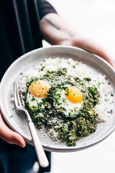 Creamy Green Shakshuka with Rice - 30 minute recipe made with cilantro, parsley, jalapeno, olive oil, almond milk, eggs, and rice. Breakfast, lunch, OR dinner! | pinchofyum.com