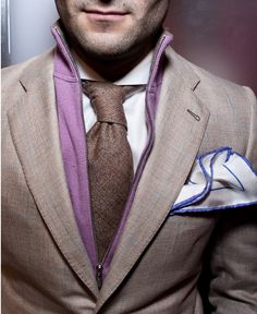 The cut of the collar, the roll of the tie, the shade of purple and the handkerchief for good measure.