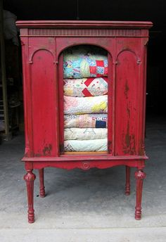Take off the middle door, add some red paint and voilà; quilt cabinet