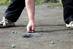 Photos from marbles tournaments.