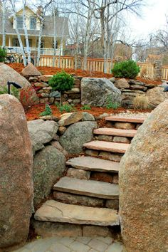 Stone steps with flagstone treads.  Installed within boulder walls.