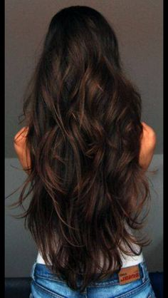 Long layered hair with brunette tones