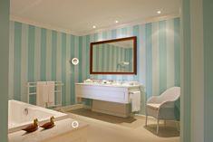 """Considerado um dos melhores hotéis do Porto, o The Yeatman Hotel é um marco distintivo e único no panorama mundial de hotéis de luxo. Apesar de ter sido inaugurado em 2010, a sua decoração neoclássica transporta-nos para uma época mais antiga, sendo que o contraste entre o """"novo"""" e o """"velho"""" constante no interior deste hotel.  Agradecimento e créditos das imagens: The Yeatman. Decor, Blue Striped Walls, Lighted Bathroom Mirror, Bathroom Mirror, White Bathroom, Sophisticated Bathroom, Design Your Home, White Bathroom Interior, Striped Walls"""