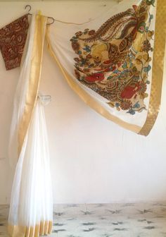 A personal favourite from my Etsy shop https://www.etsy.com/in-en/listing/467033162/white-net-kota-saree-with-gold-border