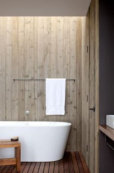 A Simple and Modern bathroom with clean lines and wood panneling provides the ultimate relaxation. #bathroom #design