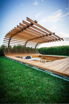 Beautiful modern pergola shading a sunken seating area