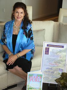 Generosi-Tea (c) - Author Mara Purl welcomes guests to the beautiful private home where her special event was held.