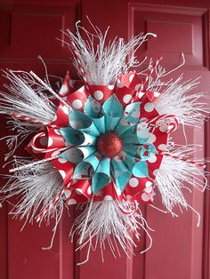 Aqua and red wreath looks like it's from whoville. change paper colors to 4th of July and silver instead of white for firecrackers. color change for autumn etc!