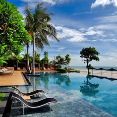 The impressive infinity pool overlooks the secluded beach.