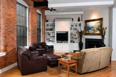 Central New York condo with built-in shelving and fireplace