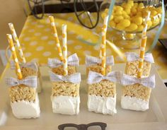 Cute idea! Rice krispie treats on striped straws dipped in chocolate and a decorated with a bow tie.