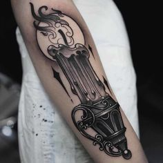 candle tattoo on arm