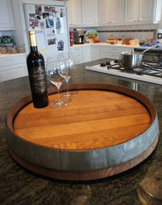 Check out this handmade wine barrel lazy-susan that my friend makes! Shabby chic!