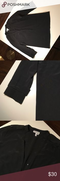 Lacoste black silk blouse Black silk blouse, loose fitting with detailing on the shoulders and sleeves. In great used condition. Lacoste Tops Blouses