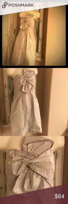 SALE✨J.Crew🍸 Cocktail formal gray bow dress Sz:8 J.Crew 🍸 light silver / grey Cocktail dress Sz:8  This is gorgeous & so stunning! I love the bow design! It's a light silver grey material. The back has size adjustments in the bust & waist! 😍 This will need dry cleaned unless I have time to take it before it sells! Probably less than $10 to dry clean I'd think! Just gorgeous! J. Crew Dresses Strapless