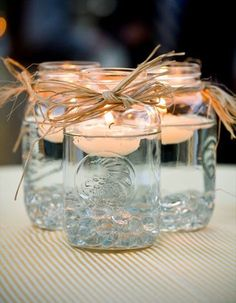 Trade in the floral arrangements for these lovely floating candles at your reception tables!