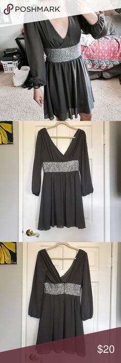 Long Sleeved Semi-Formal Dress Bought this dress through WaNeLo website, never ended up wearing it. Good for a fall wedding or similar event. 2 garment flaws from trying it on somehow: slight seam defect at bottom of zipper in back, probably easily repaired and not super noticeable when worn. Inside lining of left shoulder torn about 1 inch. Could be repaired by amateur. 100% polyester. Hand wash cold. Uno Core Dresses Long Sleeve
