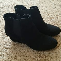 Nine West Suede Ankle Bootie Really cute Nine West ankle bootie! They are suede so they do need to be protected with a water repellent!!! They are a pull on boot with a little elastic on both sides of the boot to make it easier to get in to.  They also have a small wedge (about 1 1/2 inches). Nine West Shoes Ankle Boots & Booties