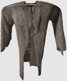 European (south east) riveted mail hauberk,16th/17th century, hip-length, open at the front with short sleeves and slit back. In the breast area is a massively executed series of alternating rows of riveted and solid rings, length 85 cm.