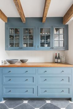 .Soft blue kitchen cabinets with beams. Elizabeth Roberts Fort Greene Kitchen | Remodelista