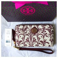 "⚜ NWT Tory Burch Kerrington Smartphone Wristlet ⚜ ⚜ Authentic NWT Tory Burch Kerrington Smartphone Wristlet / Wallet - Symphony SLG Combo White & Crimson Pattern + Gold Tone Hardware ⚜ TB Style #32159132 ⚜ Includes TB gift packaging ⚜ Durable, water resistant vinyl w/ top zipper ⚜ Removable strap converts wristlet to wallet in a snap! ⚜ Dimensions: 4"" x 6.5"" x 0.8"" ⚜ Interior: zippered coin pouch, 2 bill pockets, 2 compartments & smartphone pocket (fits up to iPhone 6/6S) ⚜  No Trades…"
