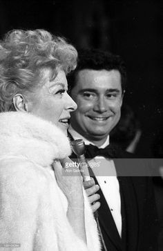 Actress Greer Garson and television personality Regis Philbin...