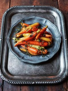 Ingredients for 12 1.5 kg carrots , use heritage ones if you can find them 2 clementines 1 tablespoon red wine vinegar 1 large knob of unsalted butter ½ a bunch of fresh thyme