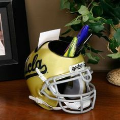 NCAA Ucla Bruins Mini Helmet Desk Caddy Holds pens, pencils and markers along with business cards Has the look of a mini helmet with the functionality of a desk caddy Officially licensed by school, has look and feel of their real helmet