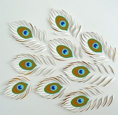 Beautiful and interesting. Paper Artwork by Lisa Rodden #peacock feathers