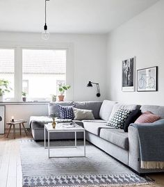 """I've fallen in love with this living room the perfect grey couch, coffee table and House Doctor rug available in our store PS who's watching Reno…"""