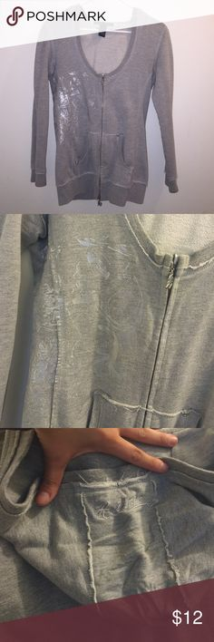 Gray Zip Up Hoodie Grey Halé Bob zip up hoodie. Scoop neck, cute zippers (zips in either direction), fitted look - not meant to be a baggy hoodie. Lays past waist for a longer look. Light silver pattern on the right side of jacket to spice it up a little, but not too overwhelming. Great for over workout clothes or a light top! Worn but in good condition. Size S. Hale Bob Tops Sweatshirts & Hoodies