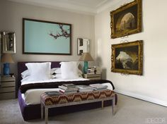 The master bedroom's custom-made bed is upholstered in suede, the mink blanket is by Loro Piana, and the custom-made bench is covered in a velvet by Gastón y Daniela; the bedside lamps are Murano glass, a pair of 1940s mirrors flanks a large-scale photograph by March, and the 18th-century paintings are by Hubert Robert.