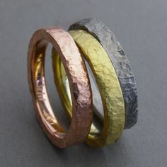 Todd Pownell: Three Rings, 3mm wide rustic, hammered bands with matte finish in 14k rose gold, 18k yellow gold, and 950 Palladium.