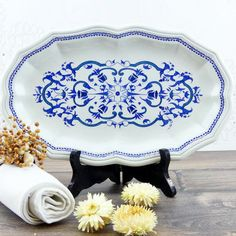 Here is an exceptional large oval serving dish with aristocratic blue decorations. It is a French dish of the famous faience factory of Salins, it is a model Segur. A famous and famous name thanks to the Countess of Ségur (Comtesse de Ségur) and her famous book Les malheurs de Sophie.  It is in a perfect state. The drawings are impeccable, no breccia, cracks or splinters. Its dimensions are immense, it is exceptional!  #dishes#tableware#service, kitchenware,plate,cup,glass,porcelain