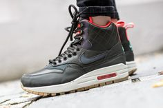 NIKE WMNS AIR MAX 1 MID SNEAKERBOOT REFLECTIVE SEQUOIA/BLACK-BRGHT CRMSN-MNT  available at www.tint-footwear.com/w-air-max-1-mid-snkrbt-rflct-300  Nike air max 1 mid sneakerboot boot h2o repel reflective sneakers tint footwear studio munich