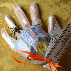 Care Packages to our Troops - candy in surgical glove - smarties in fingers, snacks size candy to fill it up - looks creepy, and if any melting happens, at least it will be contained! I Care Packages, Missionary Care Packages, Deployment Care Packages, College Care Packages, Halloween Gift Baskets, Halloween Gifts, Halloween College, Halloween Candy, Halloween Ideas