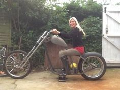 Hardbelly on her new chopper: It's a cheap hardtail frame I purchased, and I'm modifying it to make it more comfortable for us.   I managed to buy a cheap set of springer forks complete