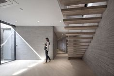 Feat Furniture Selection to Complete Feat Architecture in South Korea: Interior Busan South Korea Architecture Decoration Using Natural Grey Brick Concrete Interior Wall Panels Including Floating Solid Wooden Staircase And Rustic Solid Birch Wood Home Flooring ~ homevision.info Architecture Inspiration
