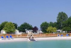 …relax in a 1500 m² natural pool surrounded by a sandy beach, at Camping L'Evasion in Landevieille
