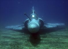 Fighter jet rises from the bottom of the sea
