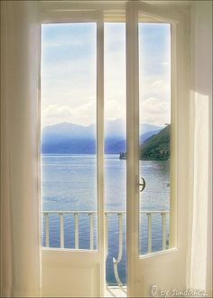 an early morning in italy, with a view to the lake como