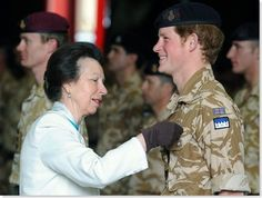 Princess Anne, The Princess Royal, presenting a campaign medal for army service in Afghanistan to Prince Harry of Wales.