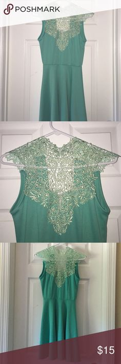 Beautiful Teal Summer Dress Never worn, without tags, it was a little to revealing for my comfort zone but beautiful enough for me to buy, the back of the neck ties up for however tight you want the neck lace area to be Dresses