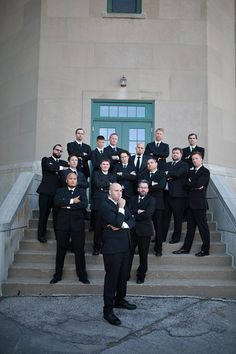 Groom and Groomsmen posing for a serious picture outside the Vets Memorial Building, taken by Michael Grobin Photography.